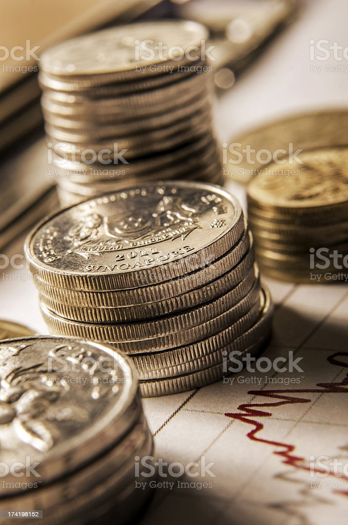 Singapore coins on graph stock photo