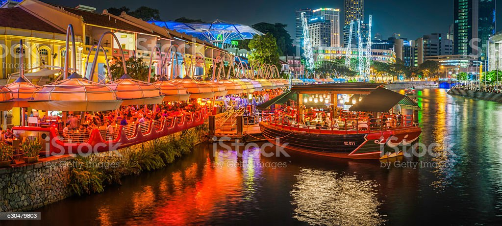 Singapore crowds at restaurants bars Clarke Quay illuminated at night stock photo