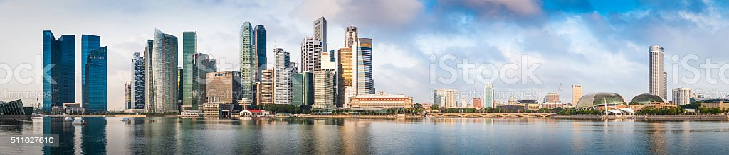 Singapore Downtown Core CBD skyscrapers reflecting in Marina Bay panorama stock photo