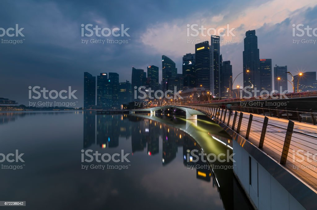 Singapore footbridge leading to business district as sunrise stock photo