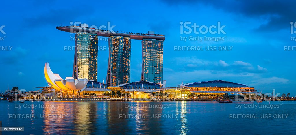 Singapore Marina Bay Sands hotel shopping mall illuminated dusk panorama stock photo