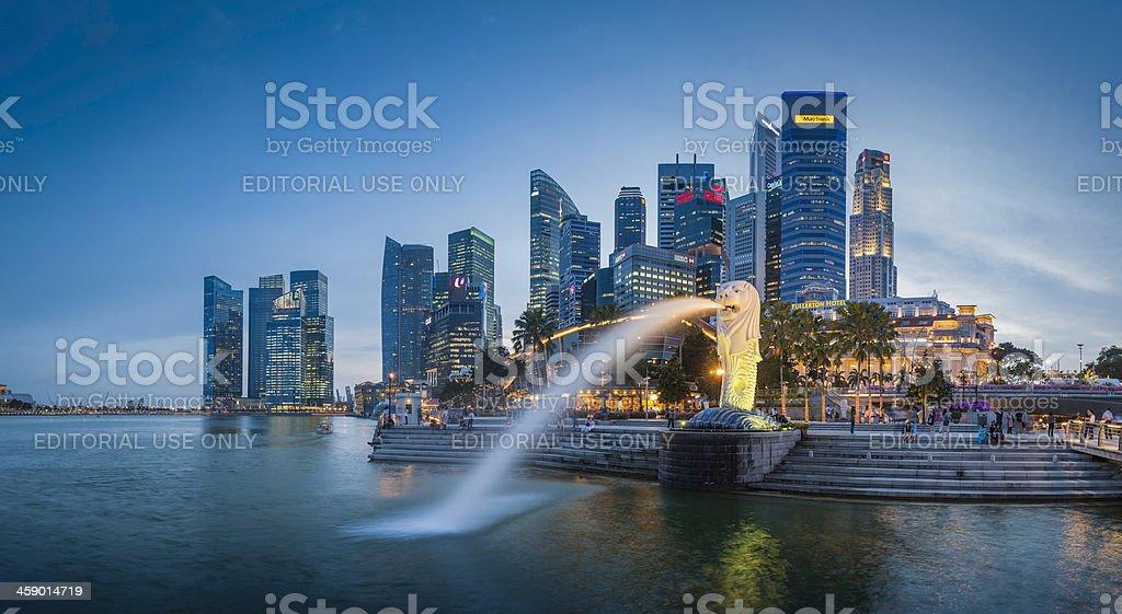 Singapore Merlion Fountain CBD skyscrapers overlooking Marina Bay at dusk stock photo