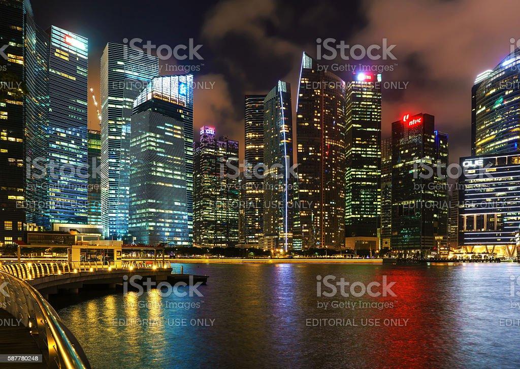Singapore skyline of Downtown Core at Marina Bay at dusk stock photo