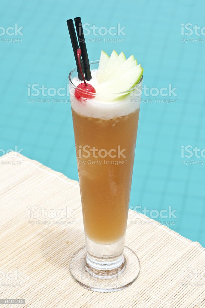 Singapore Sling classic cocktail near waterpool on the mat stock photo