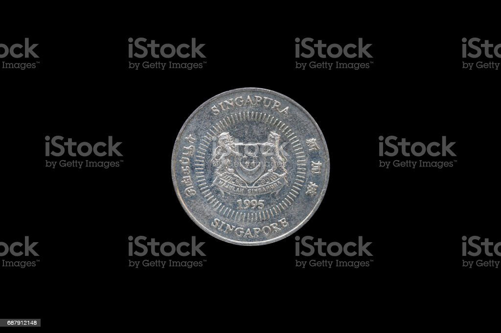 Singaporean 50 cent coin year 1995 isolated on black background. stock photo