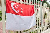 Singaporean Flag on a Fence