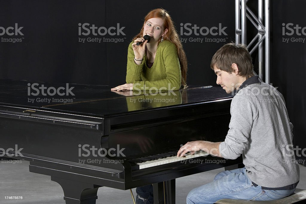 Singer and pianist royalty-free stock photo
