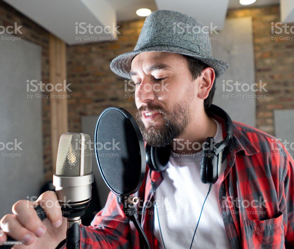 Singer at a recording studio stock photo