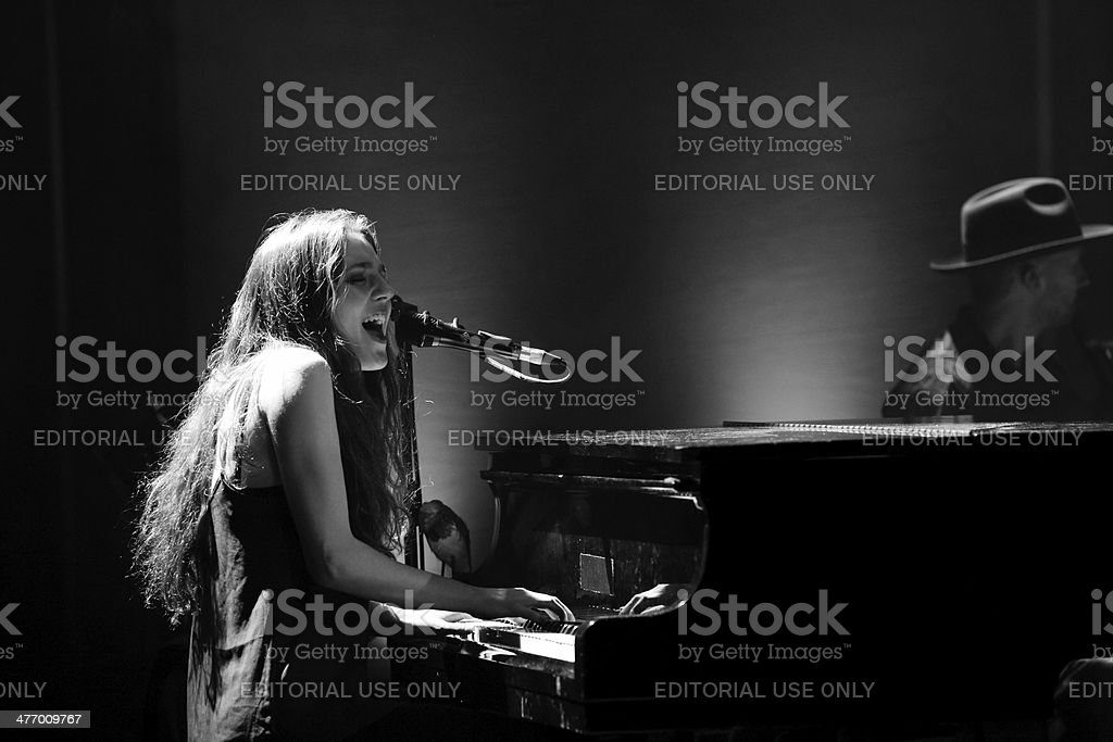 Singer Birdy at the piano with a bird stock photo