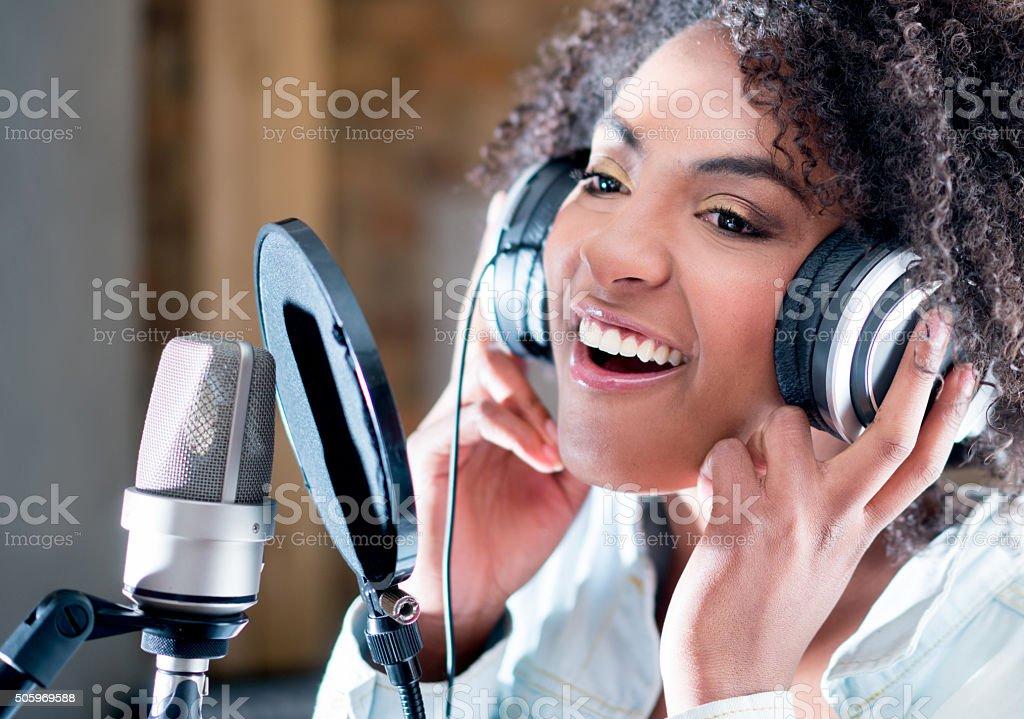 Singer in a recording studio stock photo