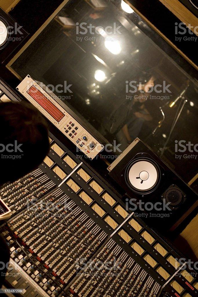 singer in audio studio stock photo