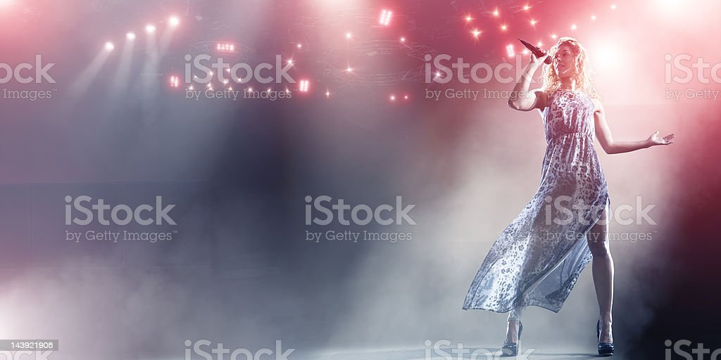 Singer Performs on Floodlit Stage stock photo
