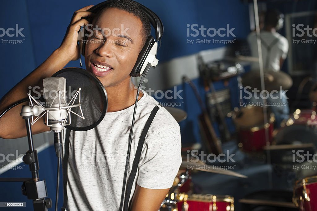 Singer recording a track in studio stock photo
