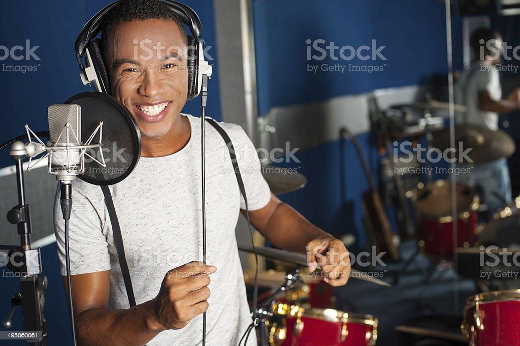 Singer recording his new track in studio stock photo