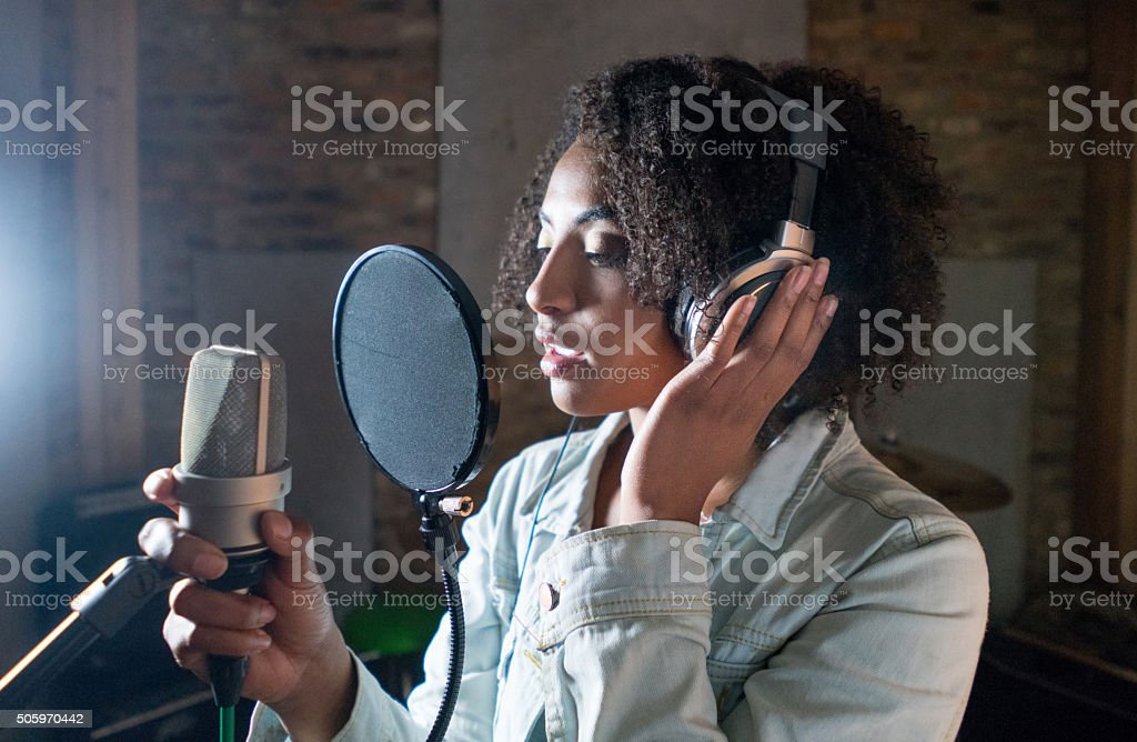 Singer recording in a music studio stock photo