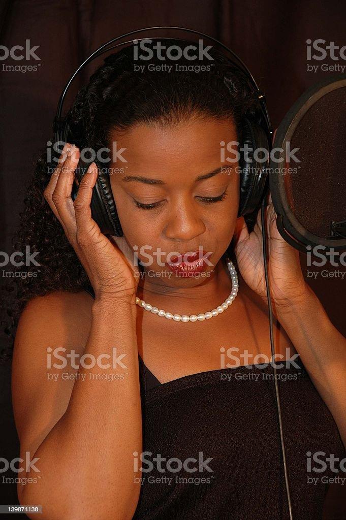 Singer recording royalty-free stock photo