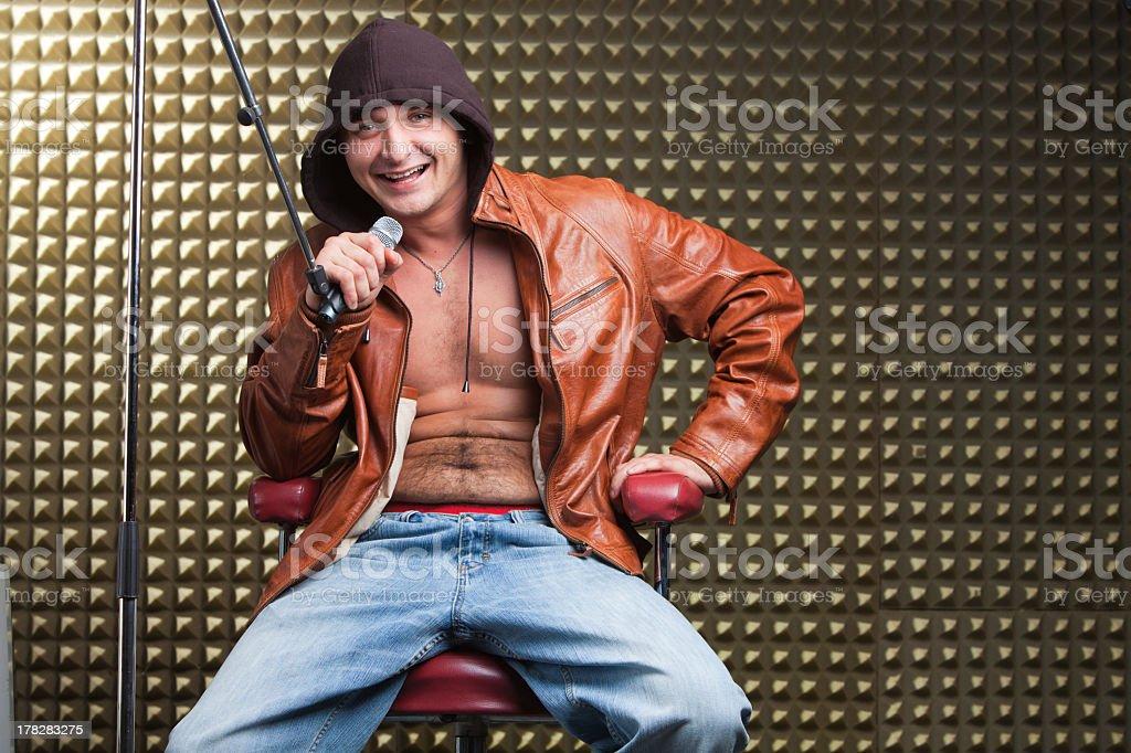 Singer sitting in recording studio stock photo