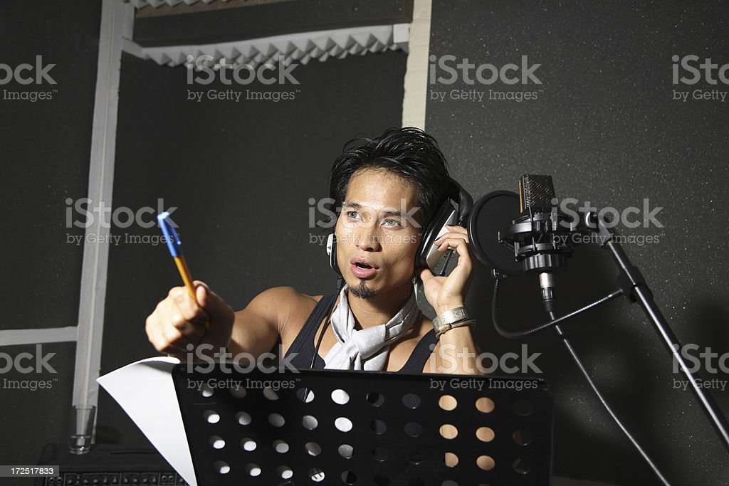 Singer/Songwriter in Recording Studio royalty-free stock photo