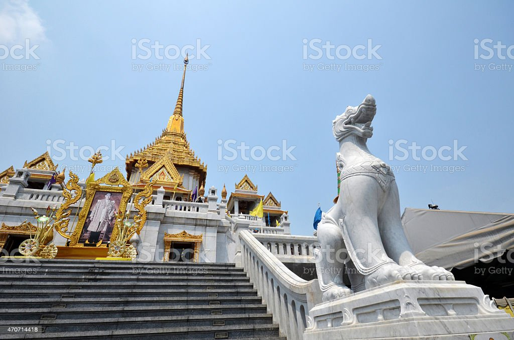 Singha and temple at Wat Trimit stock photo