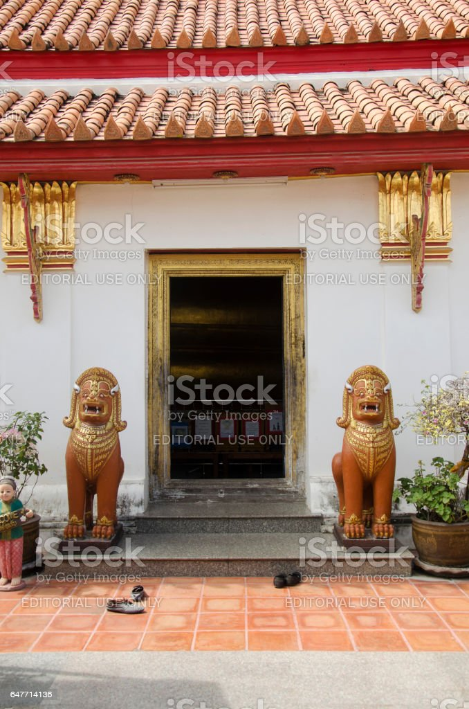 Singha or Lion guardian statues front of gate stock photo