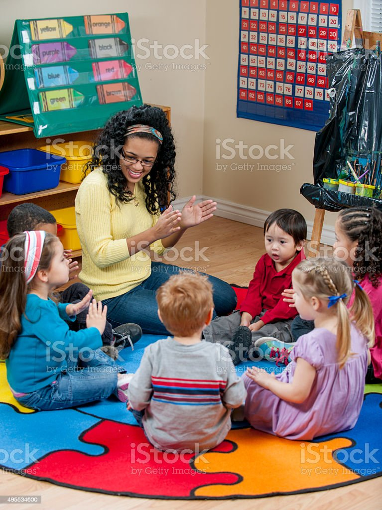 Singing and Clapping During Circle Time stock photo