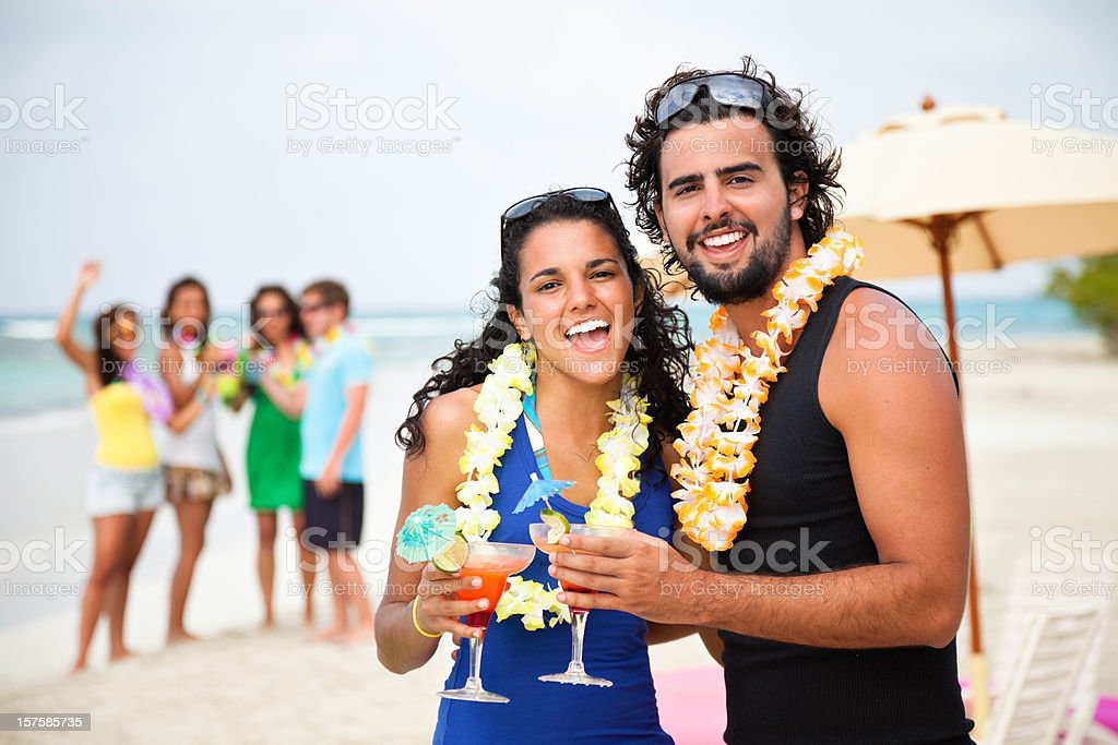 Singing attractive young couple a beach party stock photo