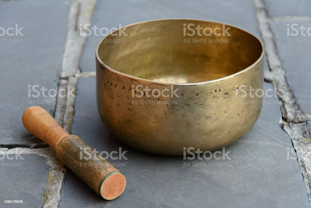 singing bowl and stick stock photo