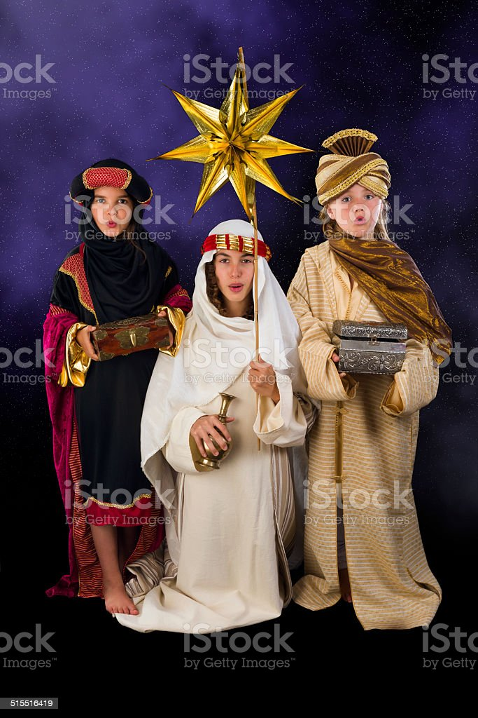 Singing christmas wisemen stock photo
