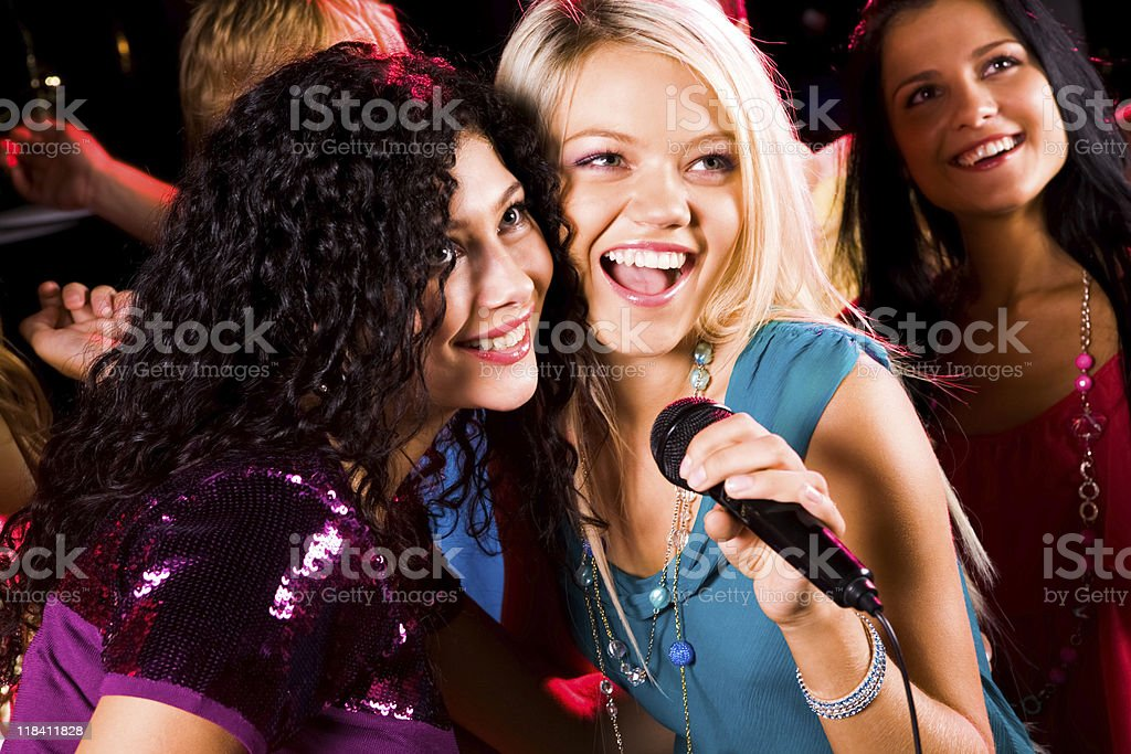 Singing girls stock photo