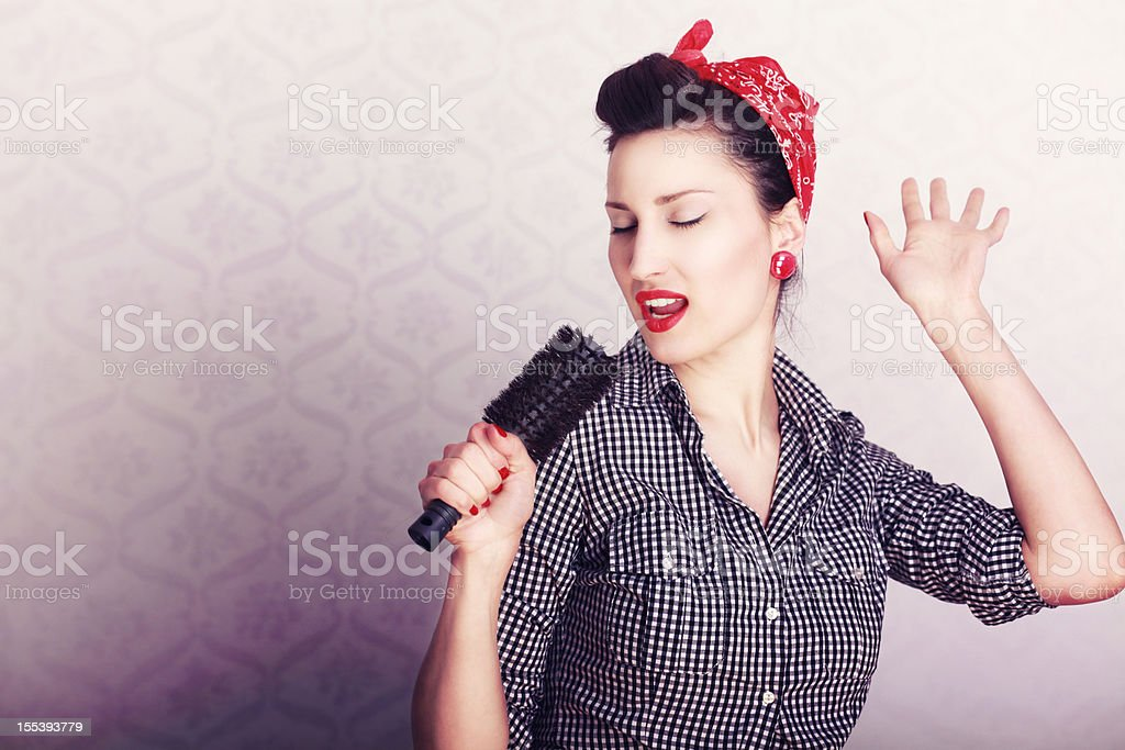 Singing Housewife stock photo