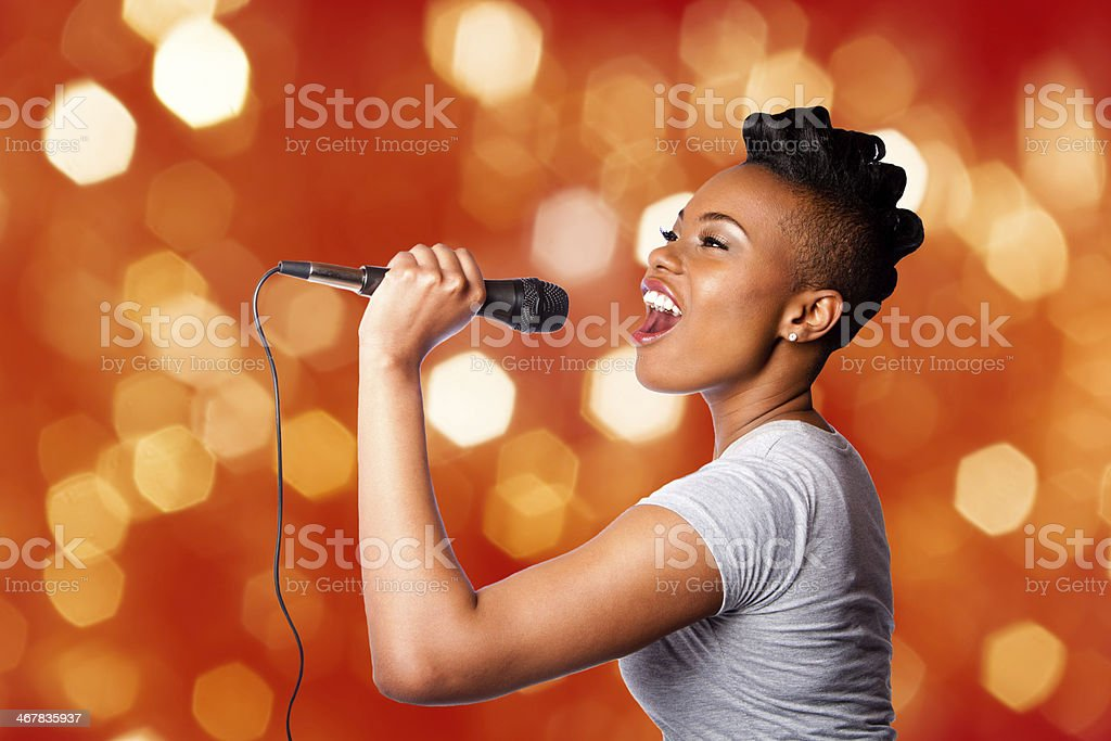 Singing kareoke woman with microphone stock photo
