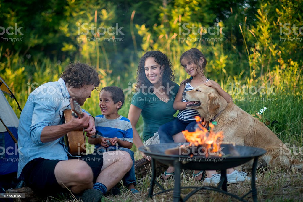 Singing Songs Around the Campfire stock photo