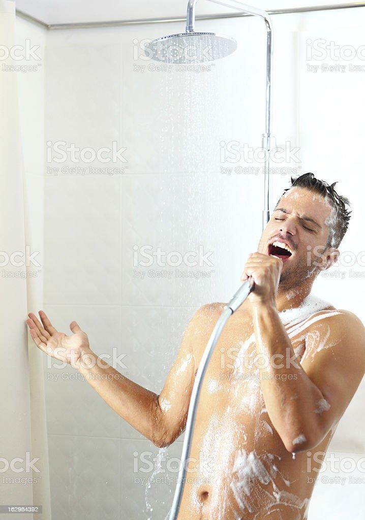 Singing under shower. royalty-free stock photo