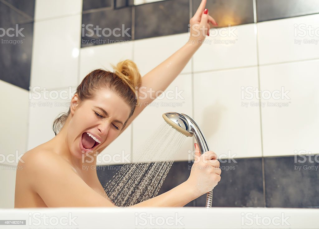 singing with the shower head stock photo