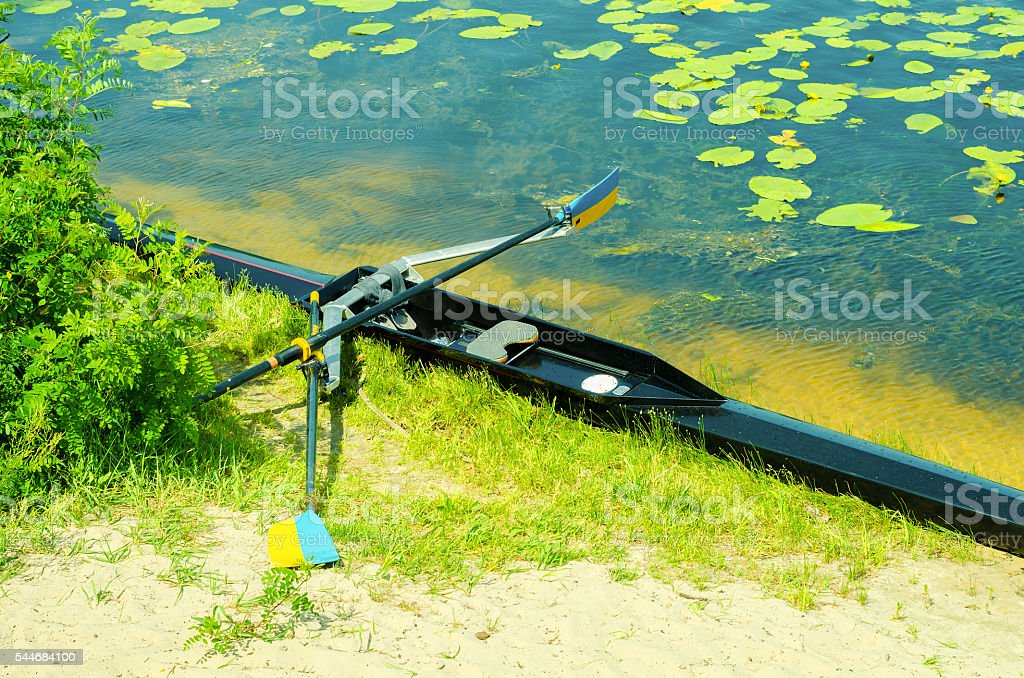 Single academy rowing boat on the beach stock photo