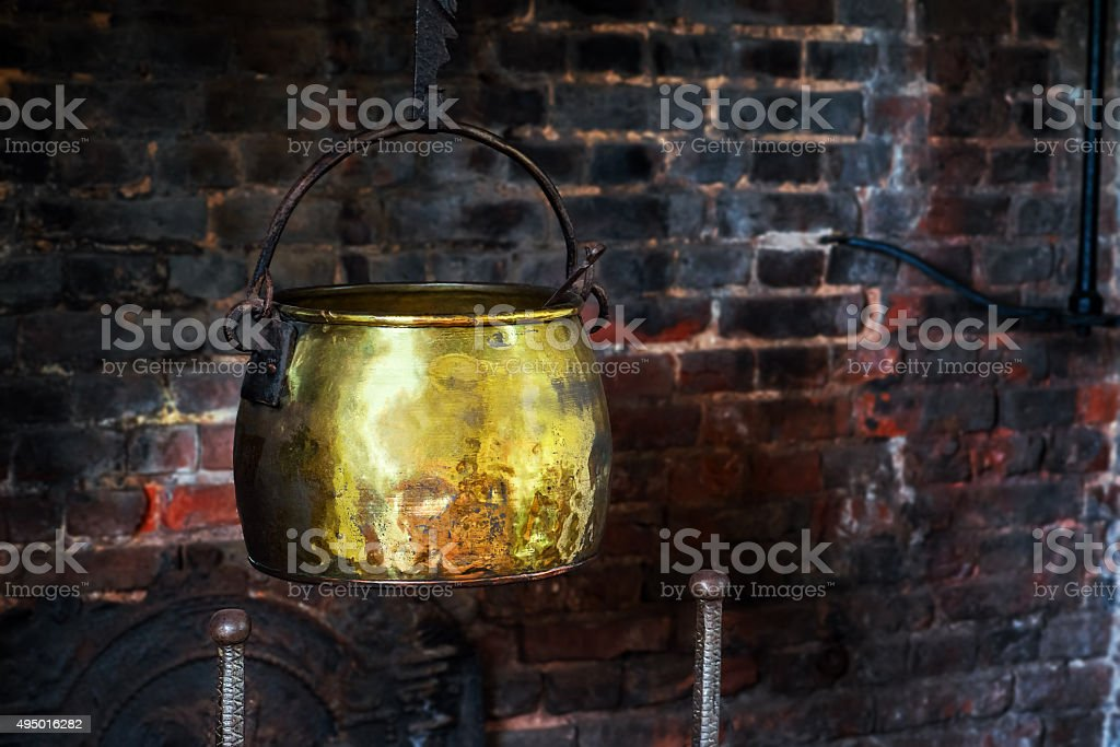 Single Antique vintage cauldron hand forged cooking pot hearth fireplace stock photo