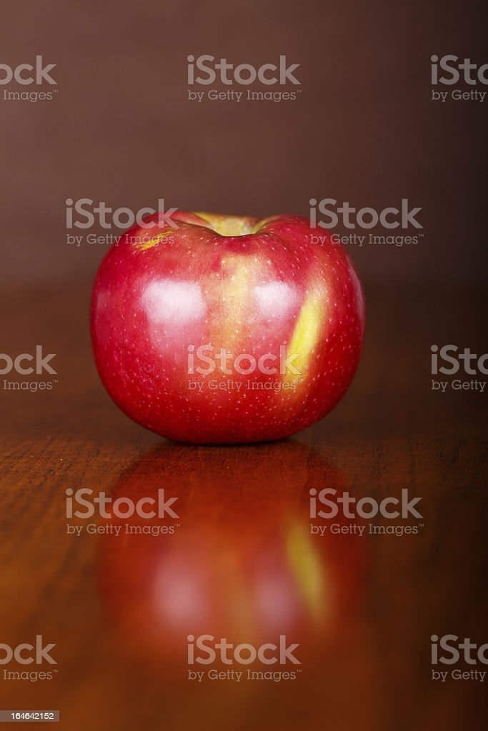 Single Apple on Table with Reflection stock photo