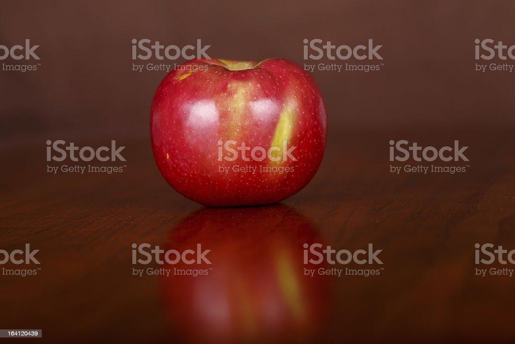 Single Apple on Wood Table stock photo