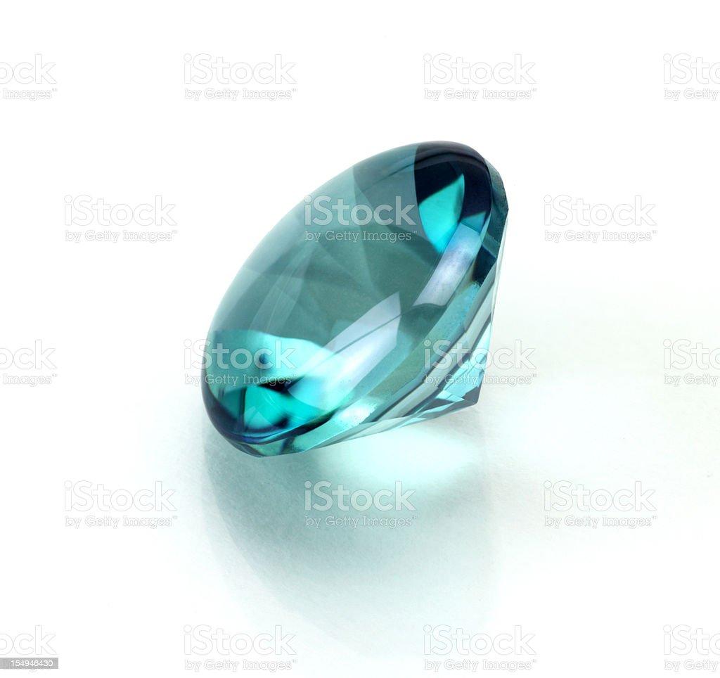 A single aquamarine or topaz round cut stone stock photo