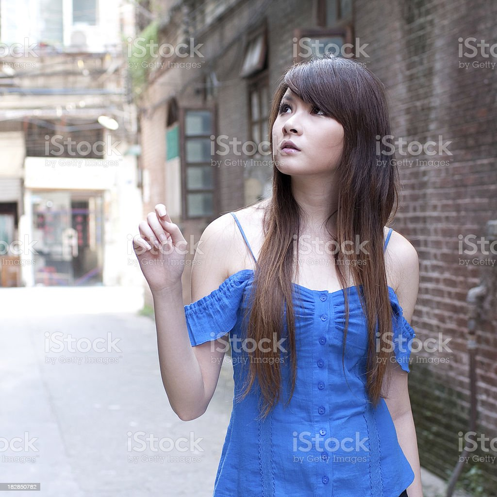 single asian young woman in  the street stock photo