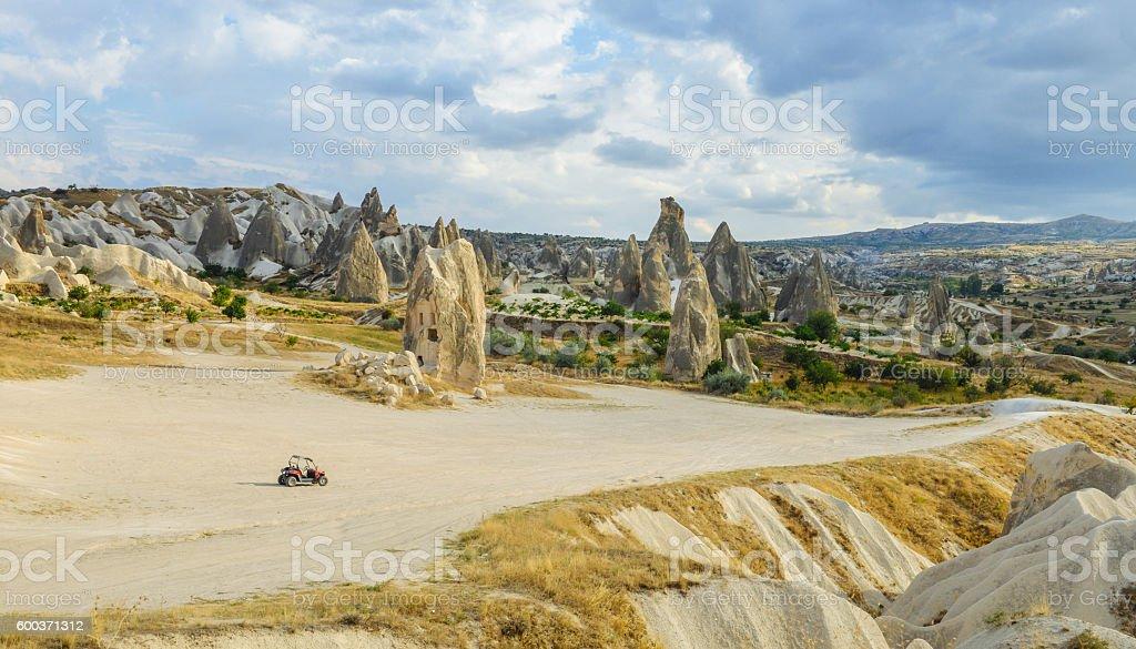 single ATV vehicle parked in wild valley in Cappadocia, Turkey royalty-free stock photo