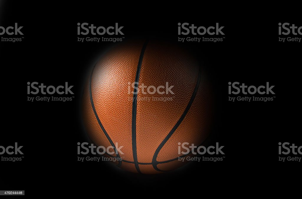 Single Basketball on a black background stock photo