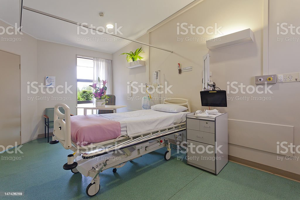 Single bed in a private hospital room stock photo