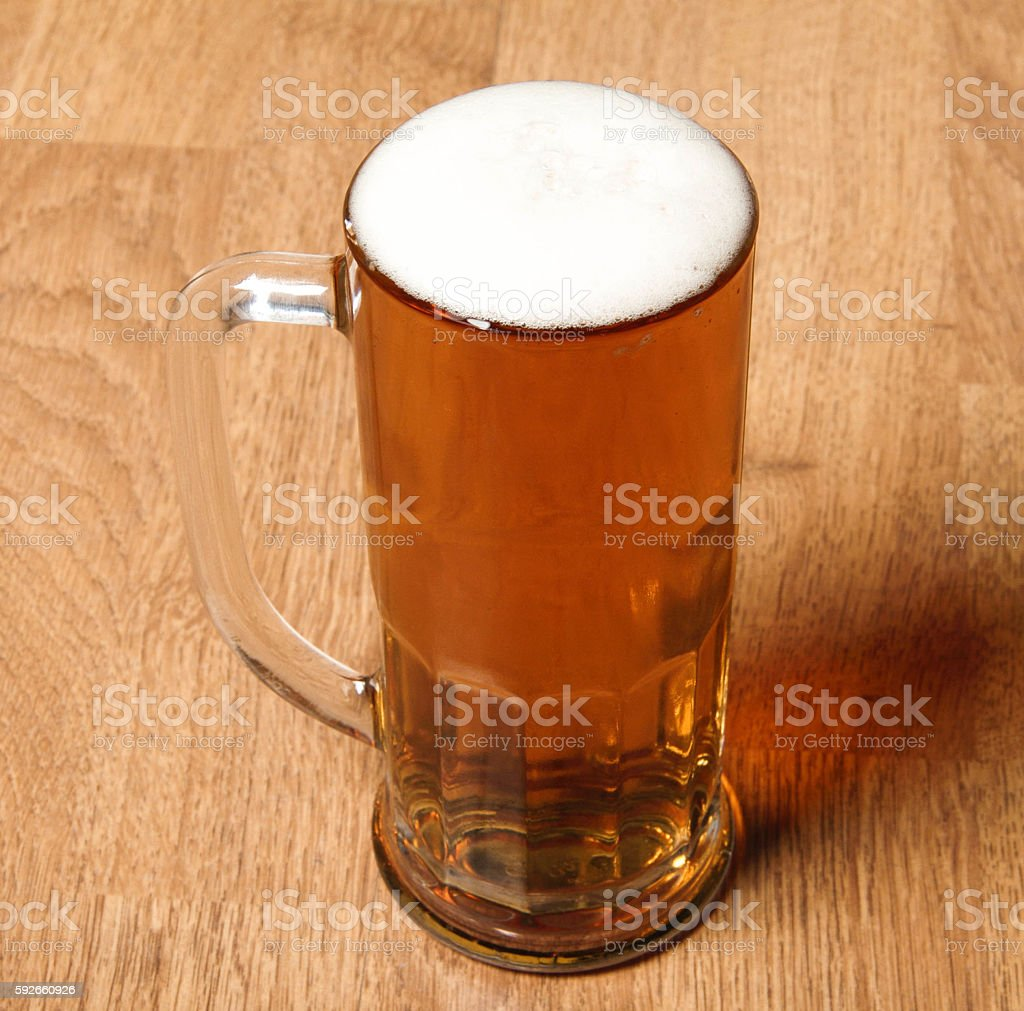 Single beer glass on wooden table stock photo