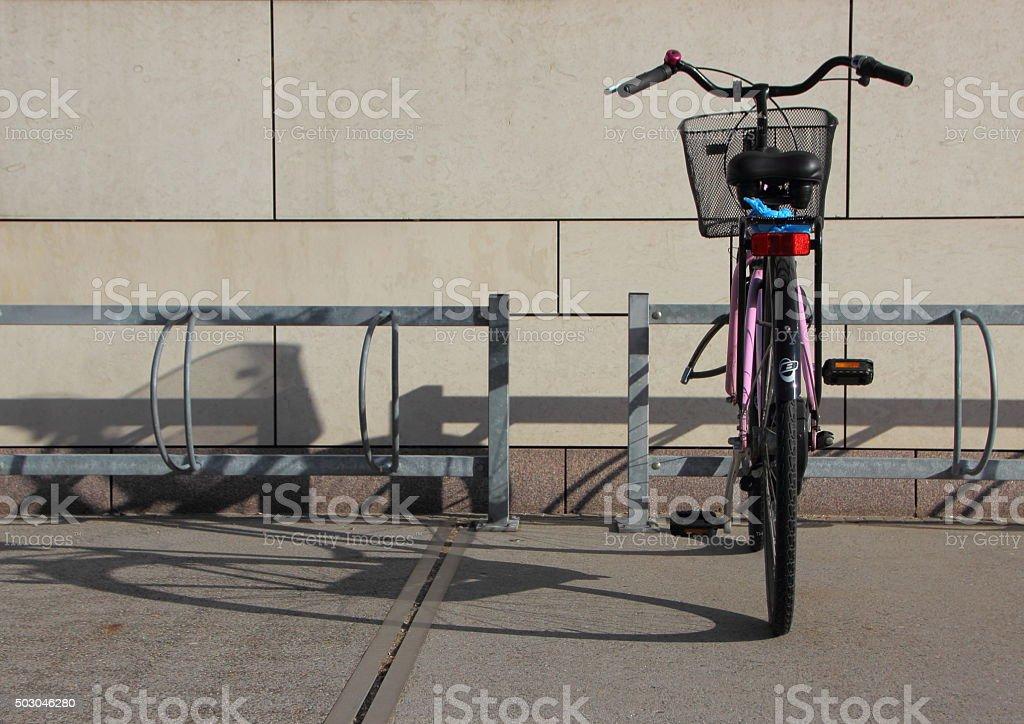 Single Bicycle in Bike Steel Mounted Rack stock photo