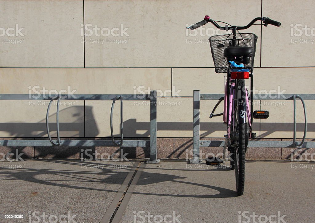 Single Bicycle in Bike Steel Mounted Rack stock photo
