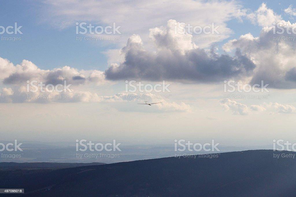 Single bird flying over mountain view stock photo