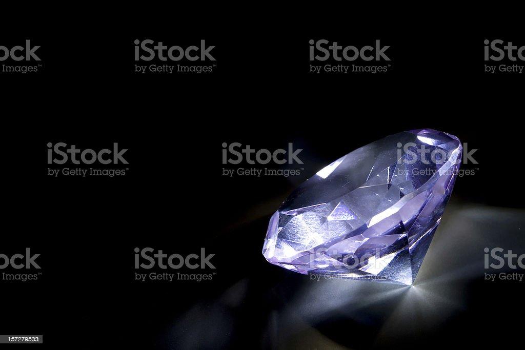 single blue diamond on black background royalty-free stock photo