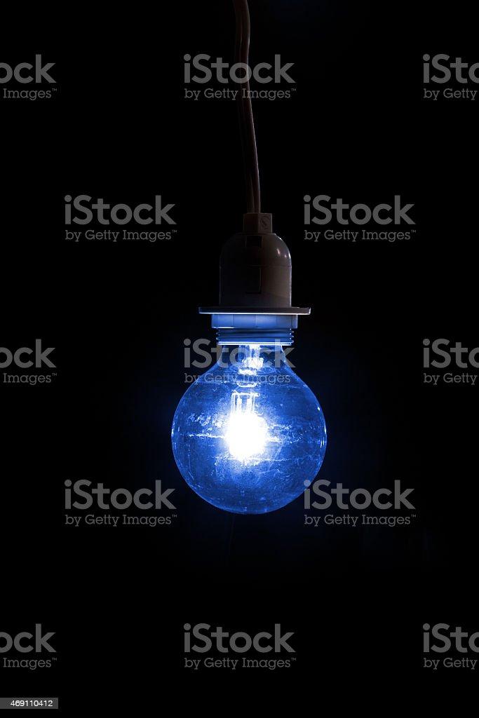 Single Blue Light Bulb - Autism Awareness stock photo