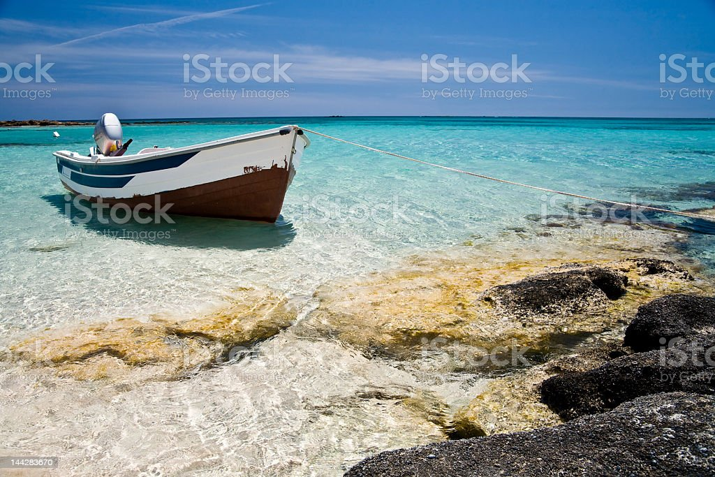Single boat sitting off the coast royalty-free stock photo
